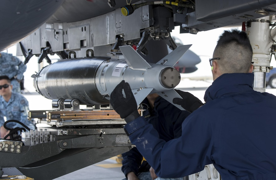 Members of the Republic of Singapore Air Force prepare an F-15SG for Combat Hammer May 1, 2017, at Mountain Home Air Force Base, Idaho. The exercise was a testament to the great working relationship between the RSAF and the United States Air Force. (U.S. Air Force photo by Senior Airman Jeremy L. Mosier/Released)