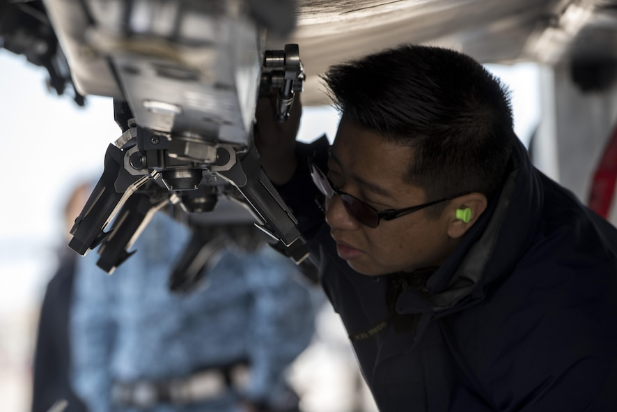 A member of the Republic of Singapore Air Force inspects an F-15SG May 1, 2017, at Mountain Home Air Force Base, Idaho. Every tiny piece of the jet must be looked over multiple times to ensure everything is perfect. (U.S. Air Force photo by Senior Airman Jeremy L. Mosier/Released)