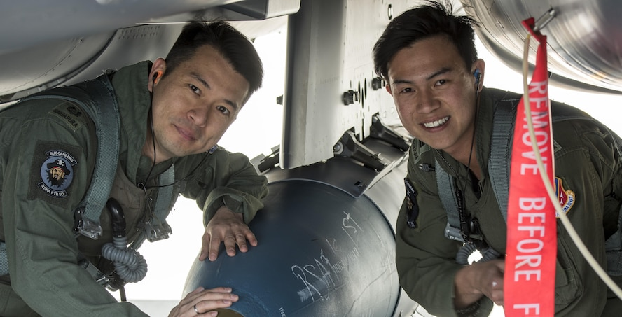 Republic of Singapore Lt. Col. Oon Kok Choon, 428th Fighter Squadron senior ranking officer, left, and RSAF Lt. Eng Jun Chao, 428th FS weapons system operator, right, pose for a photo before heading to Combat Hammer, May 2, 2017, at Mountain Home Air Force Base, Idaho. RSAF flight crew spent the week testing their weapons system capabilities during Combat Hammer.(U.S. Air Force photo by Senior Airman Jeremy L. Mosier/Released)