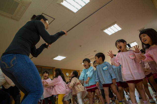 "U.S. Marine Corps Cpl. Da Hee Park, a volunteer with the Marine Memorial Chapel, pretends to be a tiger with Josho Hoikuen Preschool students during a community relations event in Iwakuni City, Japan, May 9, 2017. Volunteering at the preschool helped the relationship between Marine Corps Air Station Iwakuni residents and the local community grow stronger. Introductions were given by the volunteers while students asked them questions, then the children were introduced to ""The Hokey Pokey"" and ""Head, Shoulders, Knees and Toes"" before playing educational games with the volunteers. (U.S. Marine Corps photo by Lance Cpl. Gabriela Garcia-Herrera)"