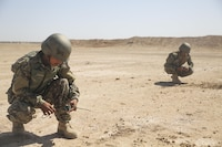 Afghan National Army soldiers with the 215th Corps prepare to tie demolition charges to a trunk line at Camp Shorabak, Afghanistan, May 10, 2017. More than 20 soldiers completed a demolition range as part of an explosive hazard reduction course, which provides students with the knowledge and skills to diminish the threat of improvised explosive devices. U.S. Marines with Task Force Southwest are assisting the Afghans throughout the training as part of NATO's Resolute Support Mission to train, advise and assist the Afghan National Defence Security Forces.