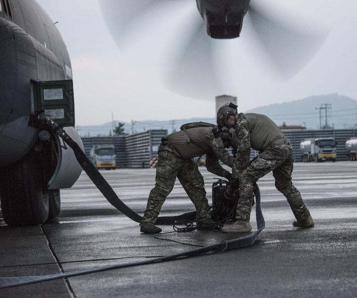U.S. Air Force forward area refueling point (FARP) technicians assigned to the 18th Logistics Readiness Squadron and loadmasters assigned to the 17th Special Operations Squadron perform FARP operations with a U.S. Army MH-47G Chinook assigned to the 160th Special Operations Aviation Regiment, April 1, 2017 at Daegu Air Base, Republic of Korea. The 353rd Special Operations Group's FARP capability enables U.S. military power projection through the refueling of aircraft operating in forward deployed locations across the Indo-Asia Pacific region. (U.S. Air Force photo by Capt. Jessica Tait)