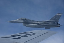 An F-16 Fighting Falcon assigned to the 120th Fighter Squadron, Colorado Air National Guard, flies near the wing of a KC-135 Stratotanker assigned to McConnell Air Force Base, Kan. after being refueled May 10, 2017, over Colorado. Aerial refueling allows aircraft to fly for longer periods of time without needing to land to refuel. (U.S. Air Force photo/Airman 1st Class Erin McClellan)
