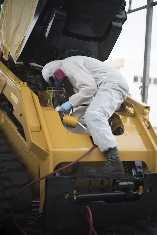 A U.S. Air Force Airman from the 18th Logistics Readiness Squadron applies anti-corrosion chemicals April 6, 2017, at Kadena Air Base, Japan. The product provides a thin layer of protection over bare metal or painted surfaces so the vehicle can resist corrosion, effectively reducing the amount of corrosion sustained and maintaining mission effectiveness for longer periods of time. (U.S. Air Force photo by Senior Airman Omari Bernard)