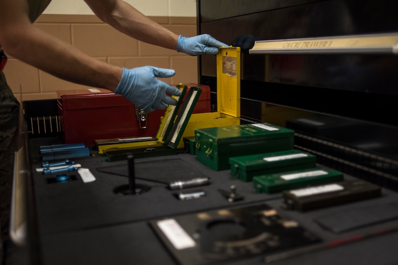 A U.S. Air Force hydraulics technician from the 18th Component Maintenance Squadron inspects a toolbox full of fitting kits May 2, 2017, at Kadena Air Base, Japan. Some of the repairs that are done in the hydraulic backshop are highly technical and often require the teamwork of several technicians to complete. (U.S. Air Force photo by Senior Airman John Linzmeier)