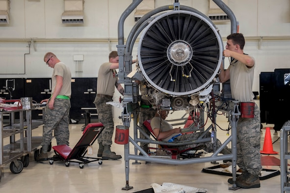 A team of aerospace propulsion technicians from the 18th Component Maintenance Squadron service an F-15 Eagle engine May 12, 2017, at Kadena Air Base, Japan. The Airmen worked together to prepare an F-15 Eagle engine for a trial run at the test cell. (U.S. Air Force photo by Senior Airman John Linzmeier)