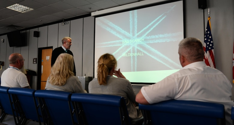Paul Nicholls, Stansted Airport security trainer, details security check point protocol dos and don'ts May, 5, 2017, with passenger service agents assigned to the 727th Air Mobility Squadron on RAF Mildenhall, England. Passenger service agents from RAF Mildenhall organized the joint training to share knowledge and experience. Training spanned three days and was held at Stansted and RAF Mildenhall. (U.S. Air Force photo by Senior Airman Justine Rho)
