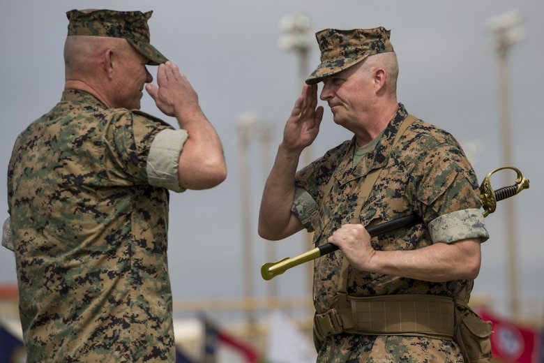 Sgt. Maj. Lee D. Bonar hands off the sword of office to III Marine Expeditionary Force Commanding General, Lt. Gen. Larry D. Nicholson during the III MEF sergeant major relief, appointment, and retirement ceremony at Camp Hansen, Okinawa, Japan on May 12, 2017. The ceremony took place to relieve Sgt. Maj. Lee D. Bonar Jr. of his duties as the III MEF sergeant major and to appoint Sgt. Maj. Mario A. Marquez in his place. Bonar, who enlisted out of Wheeling, West Virginia, retired after serving 32 years of honorable and faithful service.