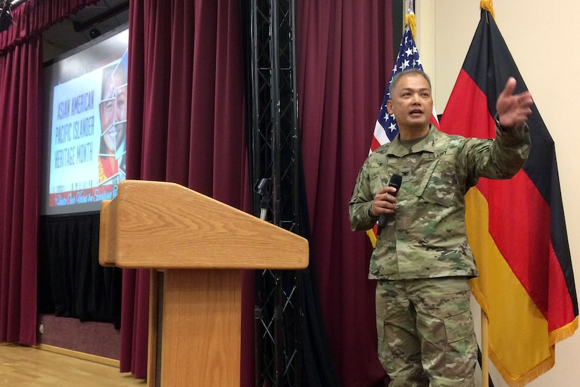 Col. Alex Wells, 7th Mission Support Command deputy commanding officer, speaks to guests of the 7th MSC and U.S. Army Garrison Rheinland-Pfalz, which celebrated Asian American Pacific Islander Heritage Month Thursday with dancing, food and fellowship. The event, which took place on Daenner Kaserne at the Kaiserslautern Community Activities Center, featured a number of musical and dance acts, as well as a variety of different foods from around the Pacific.