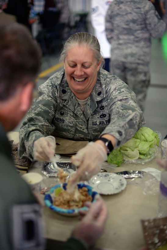 U.S. Air Force Lt. Col. Jennifer Neris, 100th Logistics Readiness Squadron commander, helps her honorary commander create a gourmet dessert during a Meal Ready to Eat Bake-off Event for Honorary Commanders' Day, May 9, 2017, on RAF Mildenhall, England. Base leadership and their honorary commanders were tasked to create a main dish, side dish, dessert and drink with two MREs. (U.S. Air Force photo by Senior Airman Christine Groening)