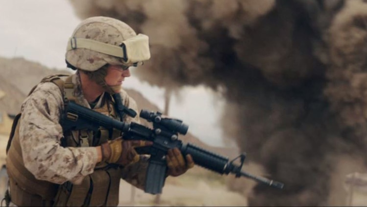 "Capt. Erin Demchko portrays a convoy commander engaged in a firefight during the filming of ""Battle Up,"" a new commercial published by the Marine Corps Recruiting Command May 12, 2017. ""Battle Up,"" like the other work in the recently-launched campaign, is aimed at the recruitable population and their influencers – parents, teachers, coaches and community leaders."