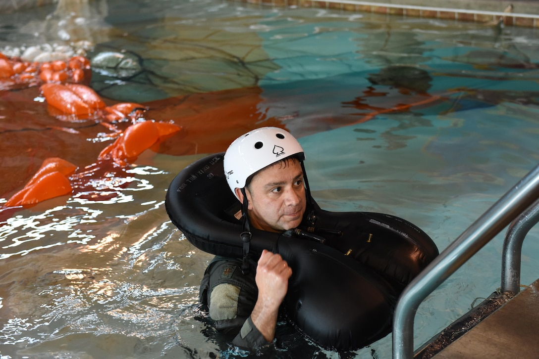 Lt. Col. Ricardo Colon, director of operations of the 112th Fighter Squadron, Ohio National Guard, climbs out of the pool May 6, 2017 after water survival training at the Aqua Hut in Toledo, Ohio. Water survival training prepares Airmen to survive in the event of having to eject out of an F-16 Fighting Falcon over water ensuring a safe return home from every mission. (U.S. Air National Guard photo by Airman Hope Geiger)