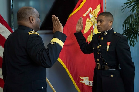 U.S. Army Brig. Gen. (ret.) Michael T. Harrison Sr. recites the Oath of Office to 2nd Lt. Mitchell Harrison during a Commissioning Ceremony at Embry-Riddle Aeronautical University's College of Business in Daytona Beach, Florida, May 10, 2017. The ceremony commemorated Harrisons' commission as a second lieutenant in the Marine Corps. Harrison completed the 10-week long Officer Candidates School and is preparing to leave for The Basic School in July 2017. (U.S. Marine Corps photo by Lance Cpl. Jack A. E. Rigsby/Released)
