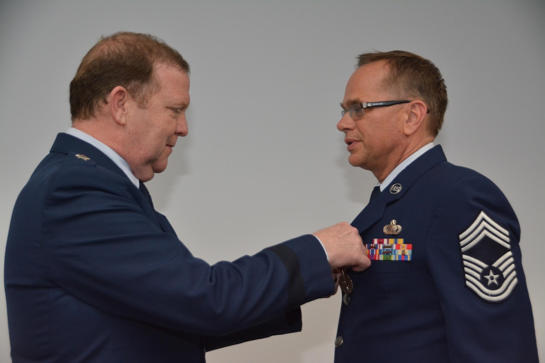 During his final commander's call, Major General Richard Scobee, Tenth Air Force Commander, presented the Meritorious Service Medal to Chief Master Sgt. Richard Ernst, Tenth Air Force Commanders Support Staff Superintendent, for outstanding service during the numbered air force transition and superior performance during the management effectiveness inspection.