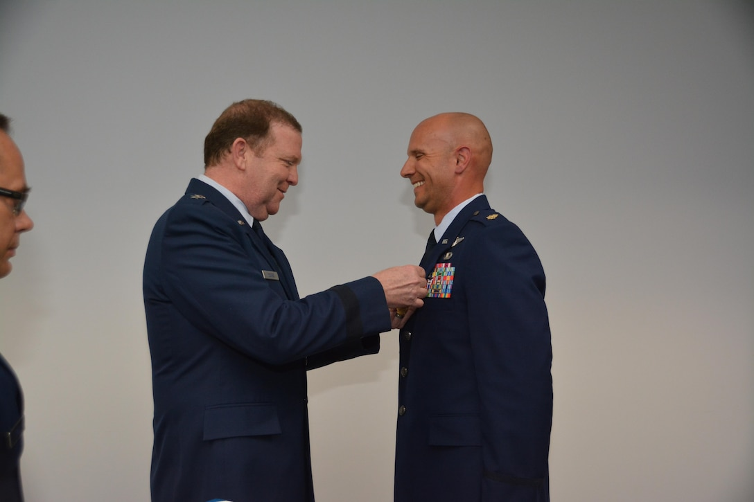 During his final commander's call, Major General Richard Scobee, Tenth Air Force Commander, presented the Aerial Achievement Medal to Major Brandon McRay, Tenth Air Force Remotely Piloted Aircraft Staff Training Officer, for aerial accomplishments in support of ongoing contingency operations.