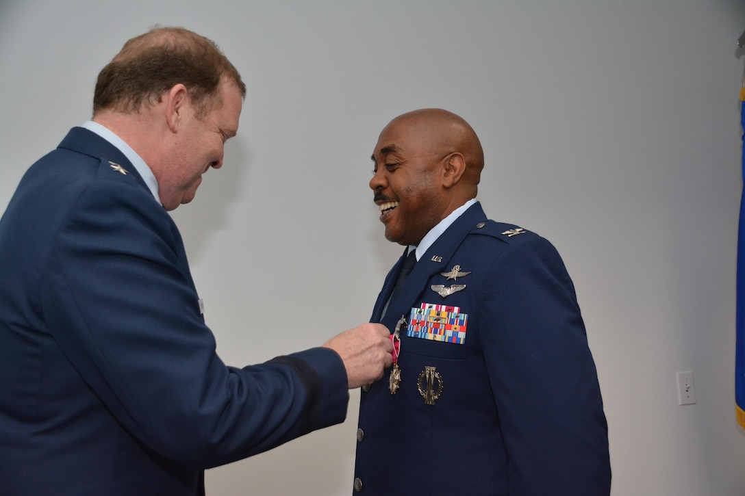 During his final commander's call, Major General Richard Scobee, Commander, Tenth Air Force, presented the Legion of Merit to Colonel Lloyd Terry Jr., special assistant and cyber operations advisor to the Tenth Air Force commander for exceptionally meritorious service while he served as the Commander, 960th Cyber Operations Group.