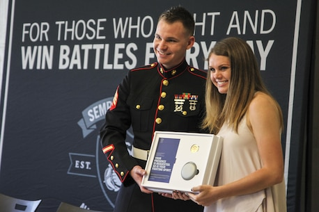 U.S. Marine Sgt. Roderick Evans presents Natasha Kusibab an invitation to attend the 2017 Battles Won Academy at Brentwood High School, Brentwood, Tennessee, on May 9, 2017. The Battles Won Academy will bring together 96 of the country's top student-leaders July 13-17 in Washington D.C. The program provides Marines with several opportunities to purposefully engage the student leaders and share leadership lessons that will enhance their future success. (U.S. Marine Corps photo by Sgt. Mandaline Hatch)