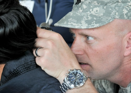 U.S. Army Lt. Col. Derrick Kooker, a medical provider with the Wyoming National Guard assigned to Beyond the Horizon 2017, checks the inner ear canal of a patient during a medical readiness event held at Macal River Park in San Ignacio, Belize May 8, 2017. This is the second of three health events held by BTH 2017. Beyond the Horizon is a U.S. Southern Command-sponsored, Army South-led exercise designed to provide humanitarian and engineering services to communities in need, demonstrating U.S. support for Belize.