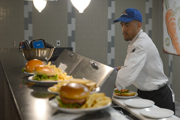 Derek Torrence, McChord Club executive chef, prepares a sandwich during lunch at McChord Grill, May 10, 2017 at Joint Base Lewis-McChord, Wash. Torrence has been the executive chef at McChord since May 2015. (U.S. Air Force photo/Senior Airman Divine Cox)