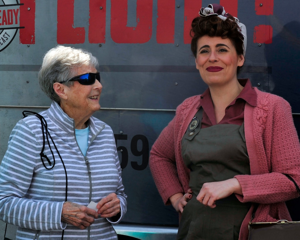 """Betty Lausch (left), who bucked rivets during WWII, talks with Marie Samson, who works with museums to pay homage to """"Rosie the Riveter"""" women of WWII, during an event at the Olympic Flight Museum honoring veterans who flew and worked on the B-17 during WWII, May 10, 2017 in Tumwater, Wash. Veterans of the war, aged 90 and older, were present to give firsthand accounts of what it was like to fly in the B-17 into combat. (U.S. Air Force photo by Staff Sgt. Whitney Amstutz)"""