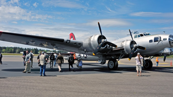 A fully-restored B-17 Flying Fortress nicknamed Aluminum Overcast sits on the runway at the Olympic Flight Museum, May 10, 2017 in Tumwater, Wash. Members of the media had the opportunity to fly on the historic aircraft and speak to veterans who either worked on, or flew the B-17 during WWII. (U.S. Air Force photo by Staff Sgt. Whitney Amstutz)