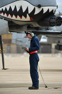 An A-10 Thunderbolt II crew chief assigned to the 23rd Aircraft Maintenance Squadron, Moody Air Force Base, Georgia, performs pre-flight checks May 2 at Hill AFB, Utah. Moody Airmen and aircraft were at Hill AFB participating in the precision-guided air-to-ground weapons evaluation exercise, Combat Hammer. (U.S. Air Force/R. Nial Bradshaw)