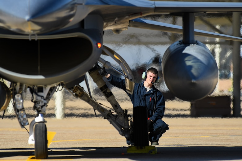 Airman 1st Class Blade Dirickson, a crew chief assigned to the 301st Fighter Wing, Naval Air Station Fort Worth Joint Reserve Base, Texas, performs F-16 Fighting Falcon pre-flight maintenance checks May 3 at Hill AFB, Utah. Airmen and aircraft from several bases participated in Combat Hammer, a two-week long exercise which evaluates precision-guided air-to-ground weapons for reliability, maintainability, suitability and accuracy. (U.S. Air Force/R. Nial Bradshaw)