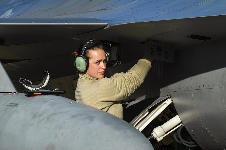 Senior Airman Christina Smith, a crew chief assigned to the 301st Fighter Wing, Naval Air Station Fort Worth Joint Reserve Base, Texas, performs pre-flight maintenance on an F-16 Fighting Falcon aircraft May 3 at Hill Air Force Base, Utah. The F-16s were at Hill AFB and the Utah Test and Training Range participating in Combat Hammer, an air-to-ground weapons evaluation exercise. (U.S. Air Force/R. Nial Bradshaw)