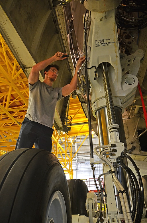 Caleb Andersen, hydraulics mechanic, checks the C-5 main landing gear for rigging May 3, 2017, at Robins Air Force Base, Ga. (U.S. Air Force photo/Tech. Sgt. Kelly Goonan)