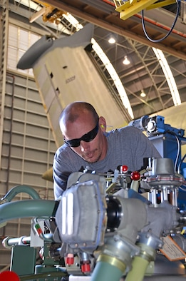 Ian Bare, Fuels, inspects a removed C-5 Fuel Tank Pressurization System (Dewar). Two 800-liter Dewar storage tanks pressurize the C-5 Galaxy's fuel tanks and are located on each side of the aircraft. (U.S. Air Force photo/Tech. Sgt. Kelly Goonan/released)