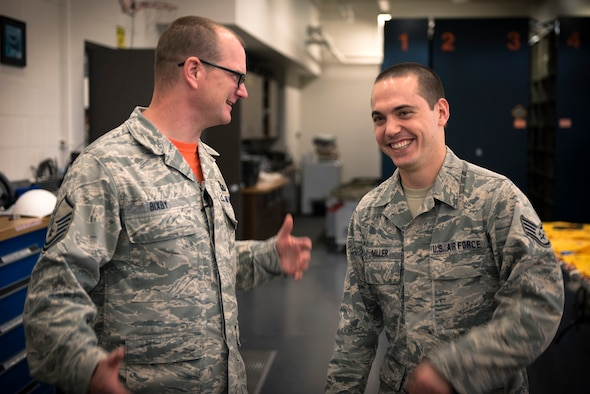 U.S. Air Force Master Sgt. Brent Bixby, left, the airfield management superintendent with the 182nd Operations Support Squadron, Illinois Air National Guard, and Staff Sgt. Ryan Miller, an aircrew flight equipment craftsman with the 182nd Operations Support Squadron, share a laugh during drill weekend in Peoria, Ill., May 6, 2017. Bixby provides Miller personal and professional guidance by serving as his mentor. (U.S. Air National Guard photo by Tech. Sgt. Lealan Buehrer)