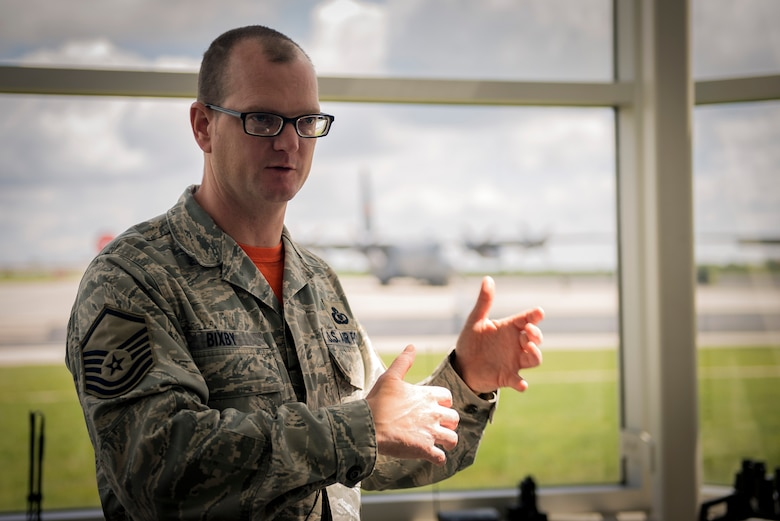 U.S. Air Force Master Sgt. Brent Bixby, the airfield management superintendent with the 182nd Operations Support Squadron, Illinois Air National Guard, explains his job duties in Peoria, Ill., May 6, 2017.  Airfield management specialists are responsible for maintaining safe airfield operating environments for aircrew and aircraft. (U.S. Air National Guard photo by Tech. Sgt. Lealan Buehrer)