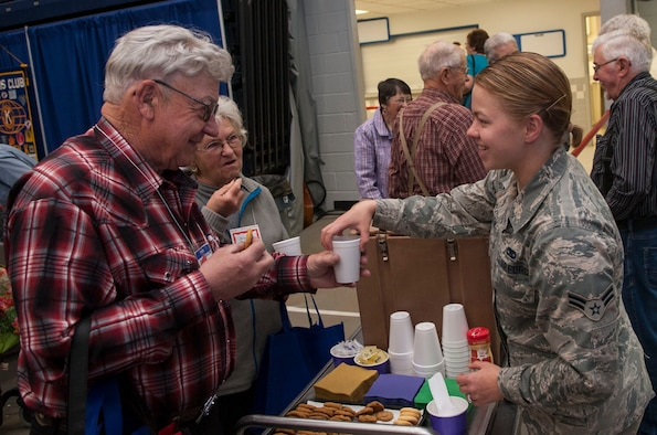 Airman 1st Class Allie Staffen, 91st Missile Maintenance Squadron facilities maintenance section technician, gives snacks to retired citizens at the annual Salute to Seniors event in Minot, N.D., May 9, 2017. Minot Air Force Base volunteers helped with security, serving food and drinks, handing out gifts, and escorting senior citizens to designated areas. (U.S. Air Force photo/Airman 1st Class Jonathan McElderry)