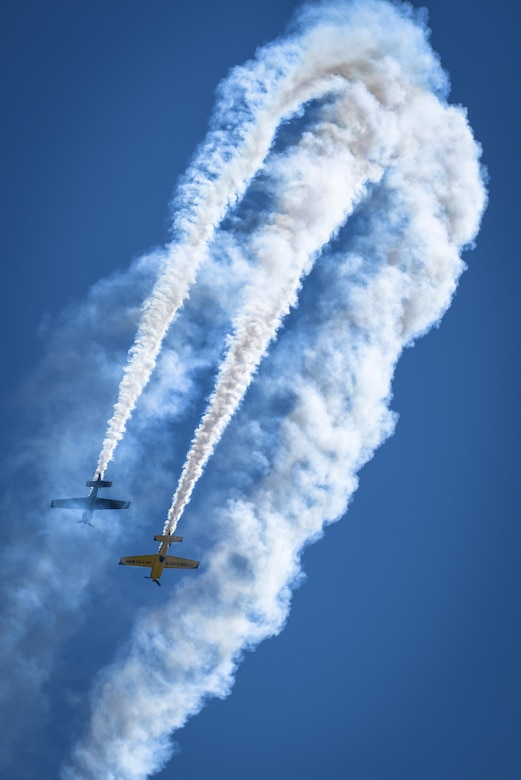 Rob Holland and Kevin Coleman perform together at the 2017 Barksdale Air Force Base Airshow, May 6. Holland pilots an MXS-RH and Coleman flies an Extra 300 LX. (U.S. Air Force photo/Senior Airman Mozer O. Da Cunha)