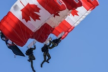 The Skyhawks, the Canadian armed forces parachute team, perform for spectators at the 2017 Barksdale Air Force Base Airshow, May 7. The Skyhawks have performed aerobatic stunts for more than 75 million spectators over 40 years. (U.S. Air Force photo/Senior Airman Mozer O. Da Cunha)