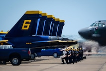 The U.S. Navy Flight Demonstration Team Blue Angels maintenance personnel take their positions behind F/A-18 Hornets prior to take off during the Defenders of Liberty Air Show at Barksdale Air Force Base, La., May 7, 2017. The mission of the Blue Angels is to showcase the pride and professionalism of the United States Navy and Marine Corps by inspiring a culture of excellence and service to country through flight demonstrations and community outreach. (U.S. Air Force photo/Senior Airman Mozer O. Da Cunha)