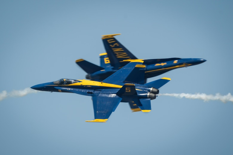 The U.S. Navy Flight Demonstration Team Blue Angels F/A-18 Hornets perform an aerial maneuver for spectators during the Defenders of Liberty Air Show at Barksdale Air Force Base, La., May 7, 2017. The mission of the Blue Angels is to showcase the pride and professionalism of the United States Navy and Marine Corps by inspiring a culture of excellence and service to country through flight demonstrations and community outreach. (U.S. Air Force photo/Senior Airman Mozer O. Da Cunha)