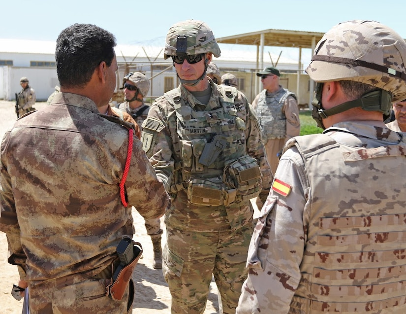 U.S. Army Maj. Gen. Martin, the commanding general of Combined Joint Forces Land Component Command-Operation Inherent Resolve, the 1st Infantry Division and Fort Riley, talks with Iraqi soldiers about the importance of the their training during a visit at Besmaya Range Complex, Iraq, April 5, 2017. The Spanish army provides specialist training at Camp Besmaya, one of four Combined Joint Task Force -- Operation Inherent Resolve building partner capacity locations dedicated to training Iraqi security forces. (Photo Credit: Sgt. Anna Pongo)