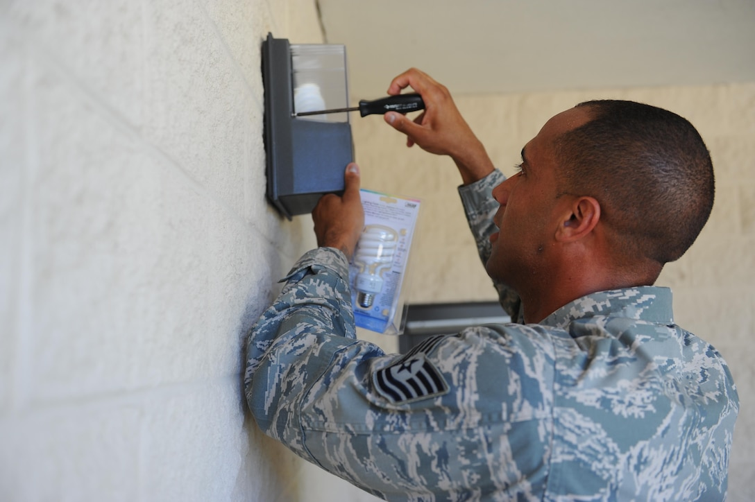 Tech. Sgt. Ryan Voisin, a fitness and sports section chief with the 1st Special Operations Force Support Squadron, replaces a lightbulb at the Aderholt Fitness Center, Hurlburt Field, Fla., May 10, 2017. The primary duty of a fitness and sports section chief is to oversee and ensure intramural sports are organized and running efficiently. (U.S. Air Force photo by Airman 1st Class Isaac O. Guest IV)