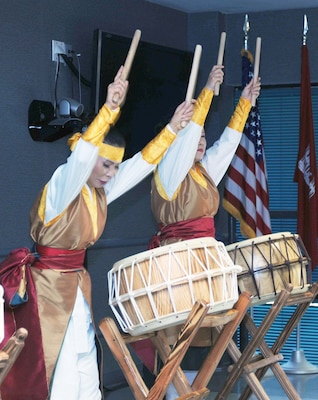 Performers at Huntsville Center's Asian American Pacific Islander Heritage Month program share Korean Nanta drumming known for its rhythmic upbeat style of percussion May 9. Traditional Korean fan dancing, Asian cuisine and a talk by Mr. Stacey K. Hirita, chief, Installation Support Division, U.S. Army Corps of Engineers also highlighted the celebration.