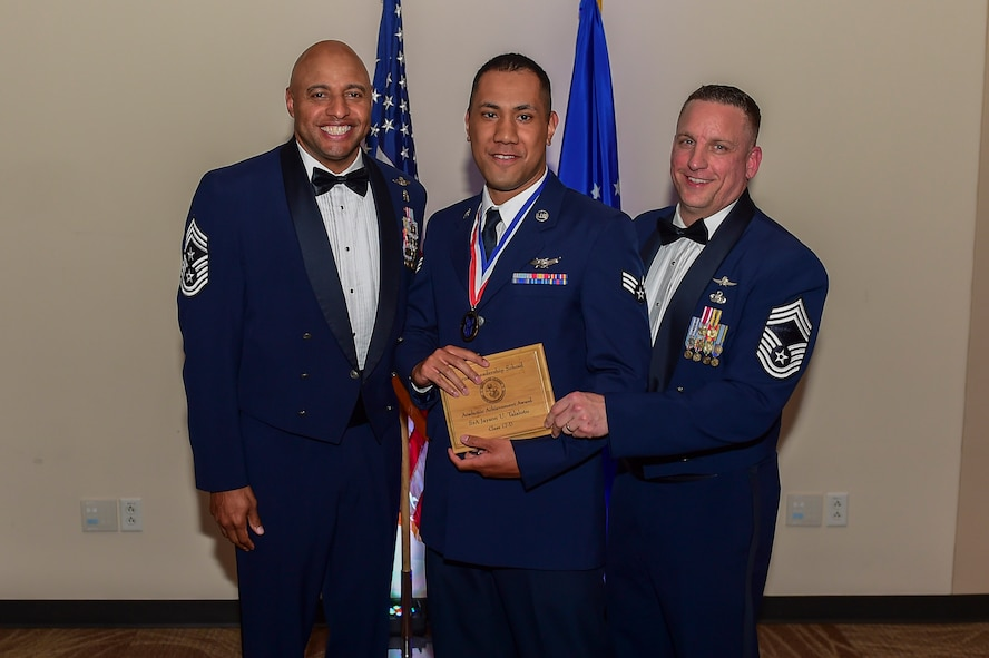 Senior Airman Jayson Talalotu, 2nd Space Warning Squadron mission crew chief, receives the Airman Leadership School Academic Achievement Award May 11, 2017, on Buckley Air Force Base, Colo. ALS is a course where Airmen learn supervisory skills necessary to succeed in the Air Force. (U.S. Air Force photo by Airman Jacob Deatherage/Released)