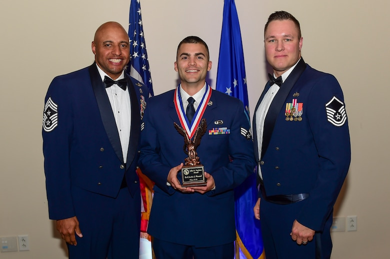 Senior Airman Justin Hanzel, 566th Intelligence Squadron electronic intelligence trainer, receives the Airman Leadership School John L. Levitow Award May 11, 2017, on Buckley Air Force Base, Colo. ALS is a course where Airmen learn supervisory skills necessary to succeed in the Air Force. (U.S. Air Force photo by Airman Jacob Deatherage/Released)