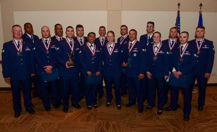Airman Leadership School graduates stand together May 11, 2017, on Buckley Air Force Base, Colo. ALS is a course where Airmen learn supervisory skills necessary to succeed in the Air Force. (U.S. Air Force photo by Airman Jacob Deatherage/Released)