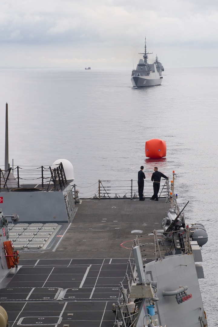 "Sailors aboard Arleigh Burke-class guided-missile destroyer USS Sterett (DDG 104) deploy a ""killer tomato"" target in preparation for Sterett, Republic of Singapore ship RSS Intrepid (FFS 69), Royal Thai Navy ship HTMS Naresuan (FFG 421), and Independence-class littoral combat ship USS Coronado (LCS 4) to conduct a live-fire exercise in support of multilateral exercise Cooperation Afloat Readiness and Training (CARAT). CARAT is a series of annual maritime exercises aimed at strengthening partnerships and increasing interoperability through bilateral and multilateral engagements ashore and at sea."