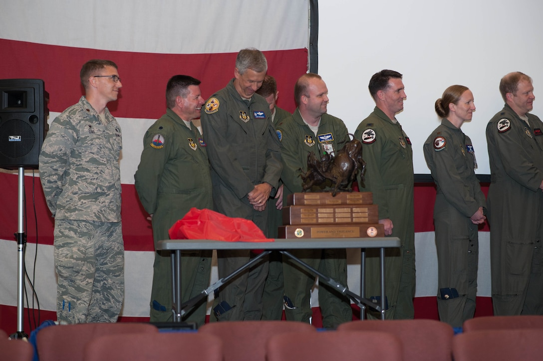 "Members of the 307th Bomb Wing celebrate after winning the Tenth Air Force Power and Vigilance Award, which is given to the unit that best exhibits the NAF mission as ""the premier provider of affordable, integrated, flexible, and mission-ready Citizen Airmen to execute power and vigilance missions in support of U.S. National security."" (U.S. Air Force photo/Maj. Rodney Ellison)"