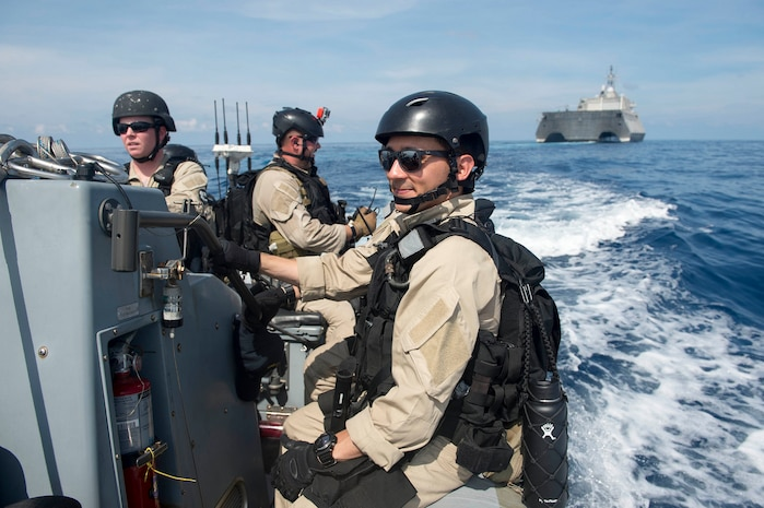 Sailors assigned to the visit, board, search and seizure team aboard littoral combat ship USS Coronado (LCS 4) prepare to board a Singaporean ship during the multilateral Cooperation Afloat Readiness and Training (CARAT) exercise, May 11, 2017. CARAT is a series of annual maritime exercises aimed at strengthening partnerships and increasing interoperability through bilateral and multilateral engagements ashore and at sea.