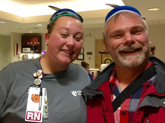 Ken Bauer, 55th Wing Plans, Program and Requirements office international program officer and senior technical advisor poses in a propeller beanie hat with Hillary Stevenson, Nebraska Medical Center registered nurse during one of his chemotherapy visits in Omaha, Nebraska. Bauer used the idea of wearing costumes to chemotherapy to keep fellow patients and staff in good spirits. (Courtesy Photo)