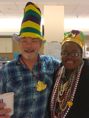 Ken Bauer, 55th Wing Plans, Program and Requirements office international program officer and senior technical advisor, enjoys a Mardi Gras moment with Montoya Johnson whose mother, like Bauer, is going through chemotherapy at Nebraska Medical Center in Omaha, Nebraska. Bauer has been using costumes during his chemotherapy visits to keep fellow patients and staff laughing and smiling. (Courtesy Photo)