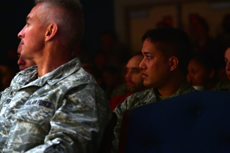 Airmen listen as Senior Master Sgt. Michael, 99th Air Base Wing superintendent community support, shares his personal experiences during the first Storytellers event May 10, 2017, at Creech Air Force Base, Nev. Storytellers aims to help Airmen connect with others allowing them to relate to one another through stories of overcoming adversity. (U.S. Air Force photo/Senior Airman Christian Clausen)