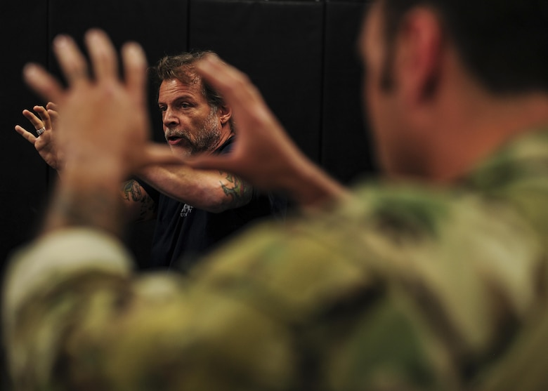 Tony Blauer, founder of Blauer Tactical Systems Inc., instructs Survival, Evasion, Resistance and Escape specialists during a week-long Spontaneous Protection Enabling Accelerated Response System course at Davis-Monthan Air Force Base, Ariz., April 27, 2017. The SPEAR System takes advantage of the human body's startle/flinch mechanism to convert an aggressor's attack into a tactical counter. (U.S. Air Force photo by Senior Airman Chris Drzazgowski)
